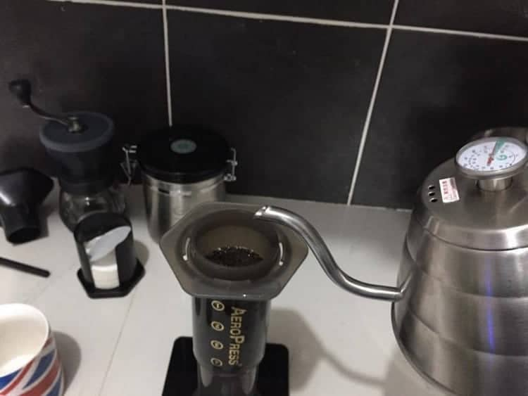 pouring hot water into the inverted Aeropress