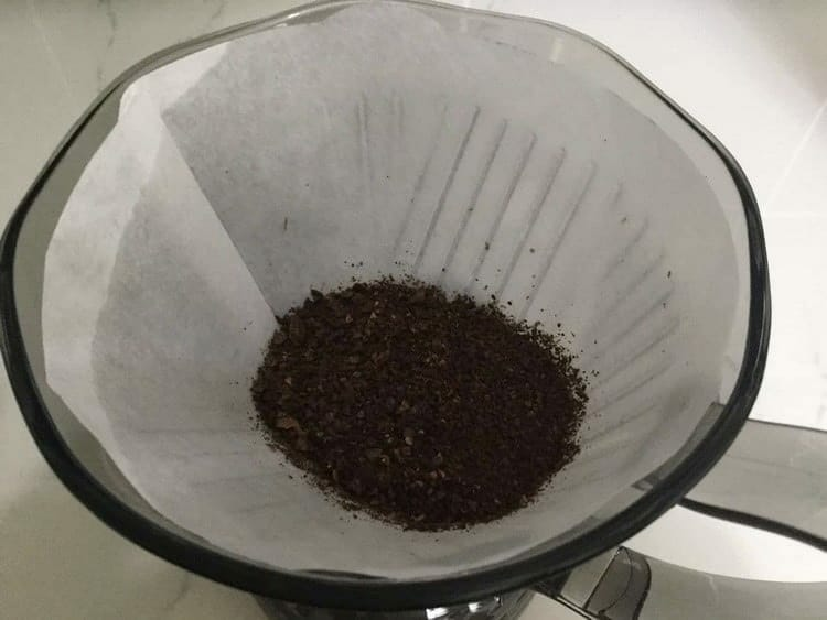 Ground coffee inside of a paper filter