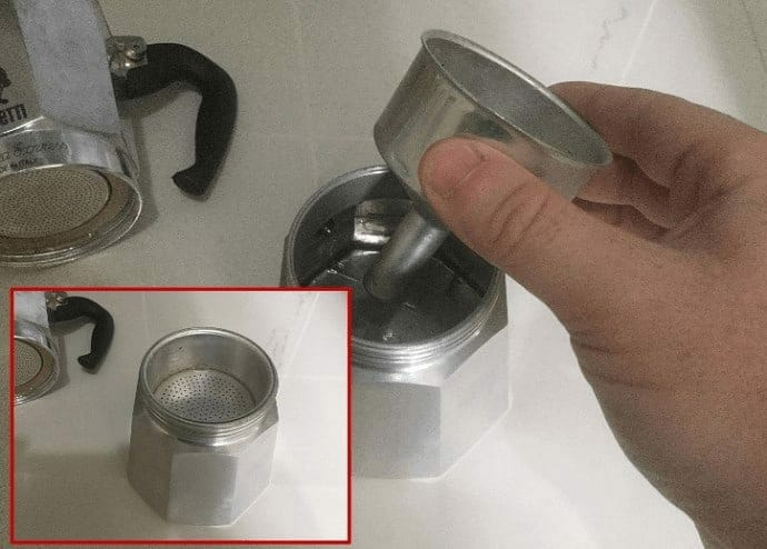 inserting the Moka Pot filter basket
