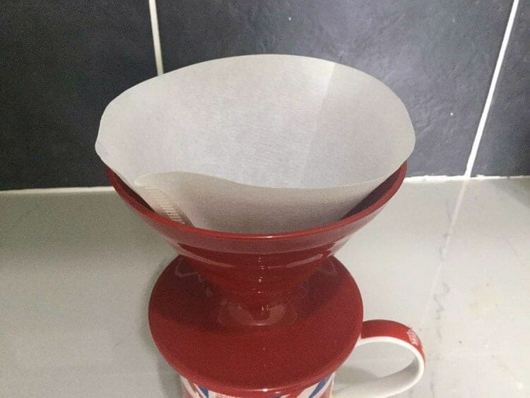Paper coffee filter inside of a V60 Dripper