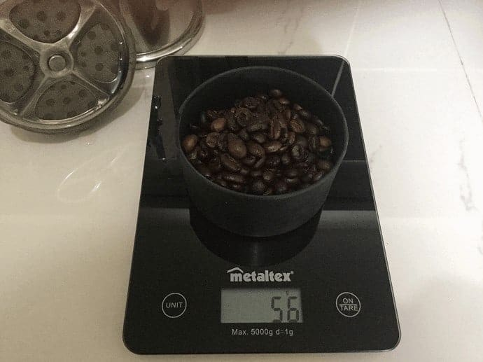 Coffee being weighed on a scale