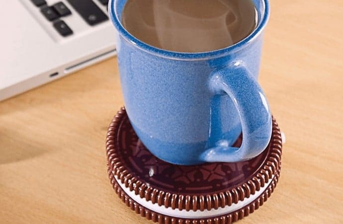 Coffee cup sat on a Oreo warming plate