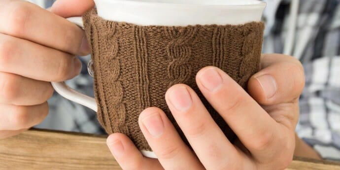 knitted sleeve on a coffee cup