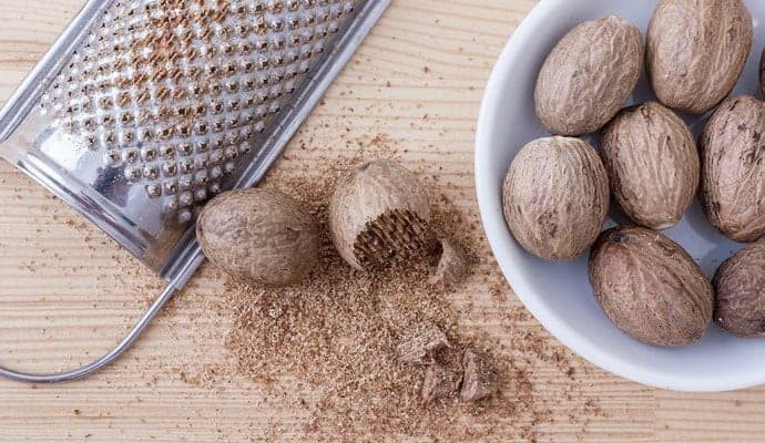 Fresh whole Nutmeg and a grater