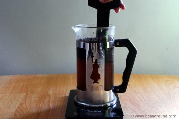 Stirring coffee inside of a French Press