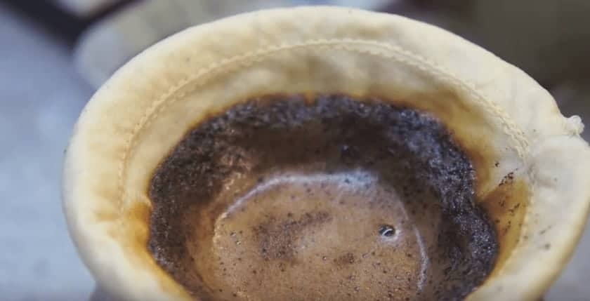 coffee draining through a sock filter