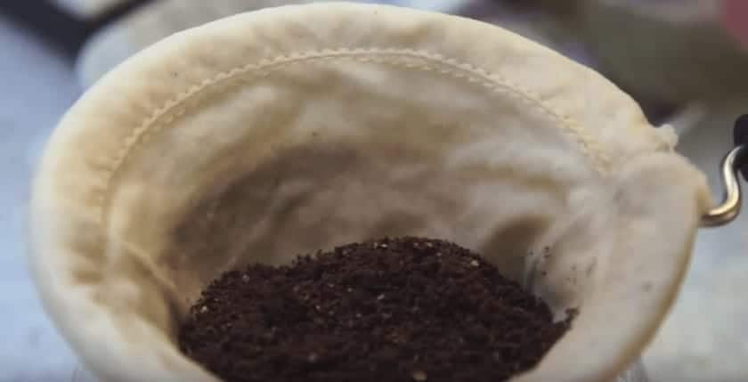 ground coffee inside of a sock
