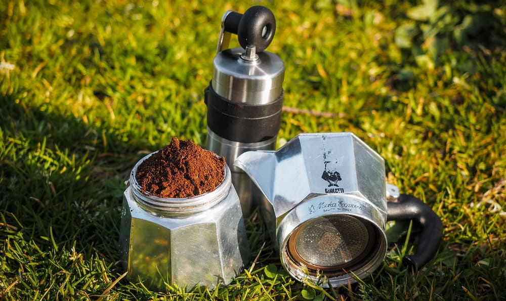 Moka Pot laying on green grass