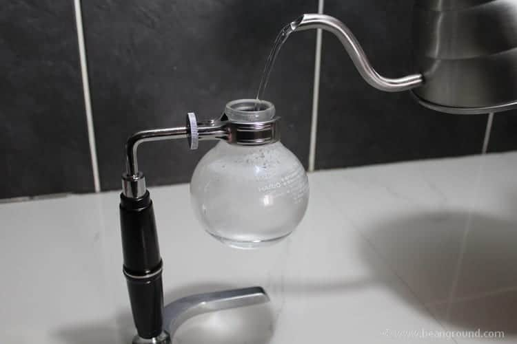 pour water into the glass bulb