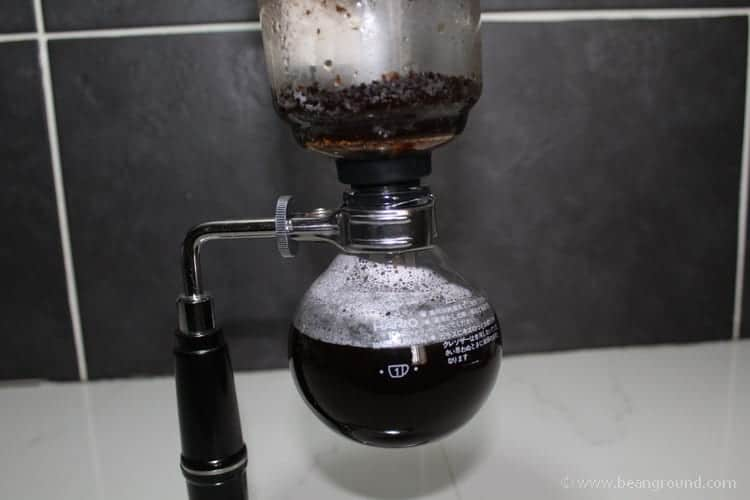 watch the coffee drop down into the bottom chamber